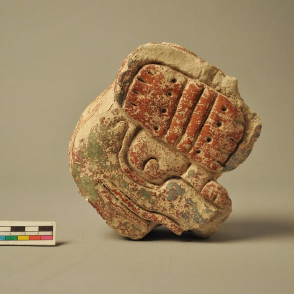 Relief of maya glyph made of stucco, Belize. Am1938,1021.403